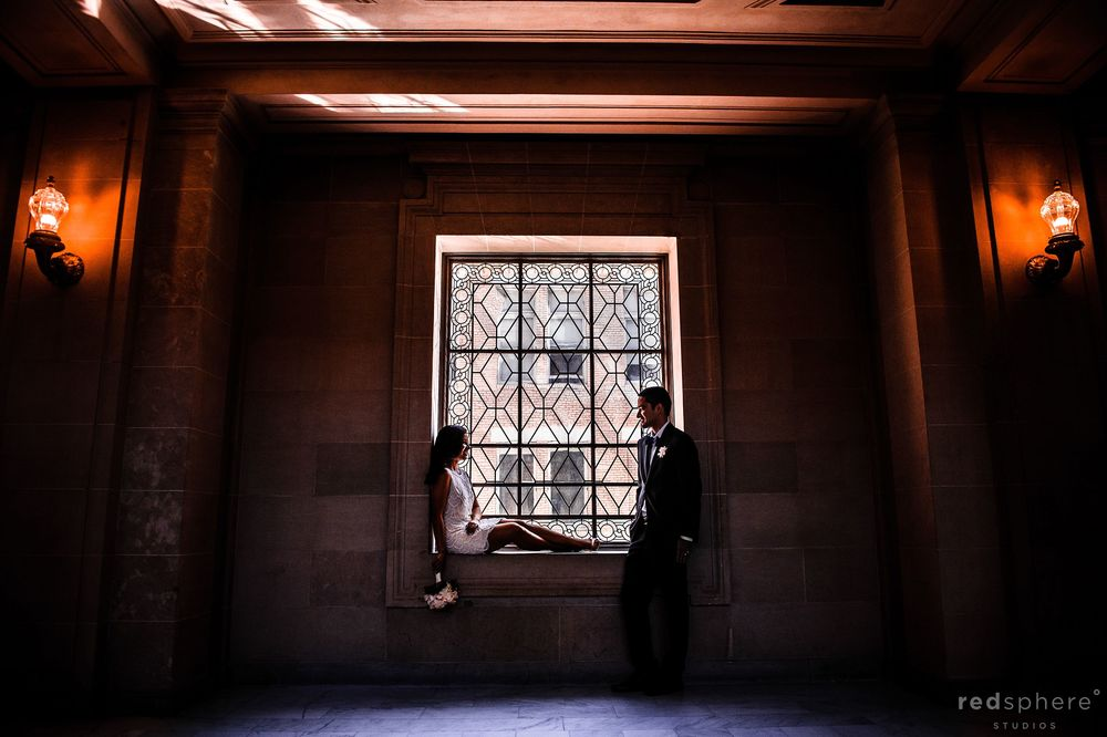 Window Sill Moment Between Bride and Groom at San Francisco City Hall Wedding