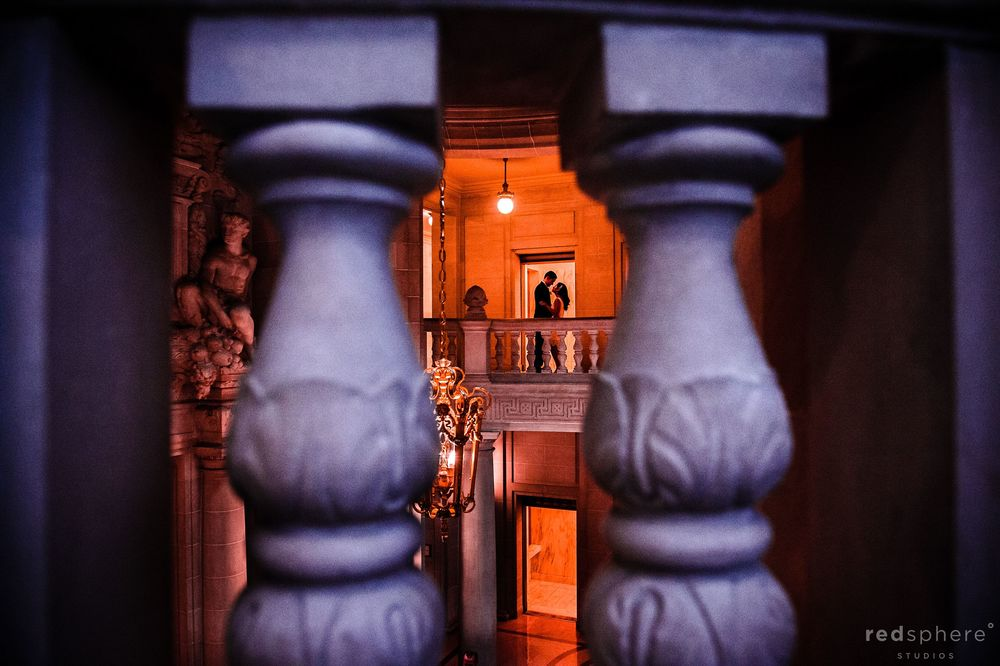 Bride and Groom Through a Set Of Pillars at San Francisco City Hall Wedding