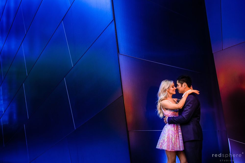 Couple Soft Embrace at Walt Disney Concert Hall Los Angeles Engagement