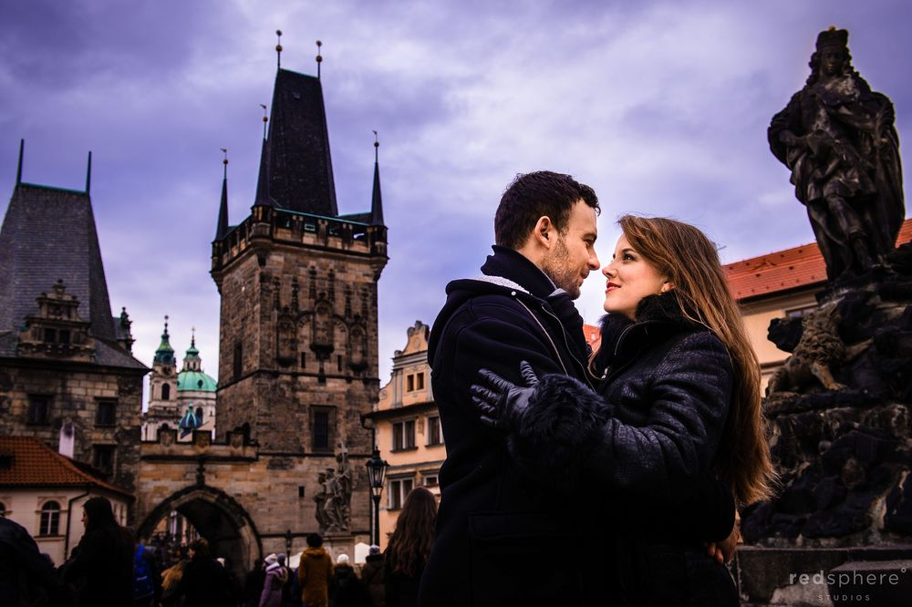 Couple Staring Into Each Other's Eyes During Destination Engagement at Charles Bridge, Prague