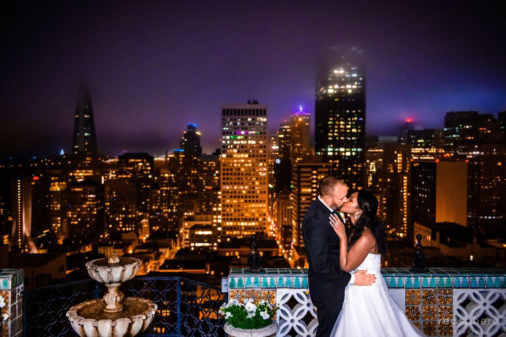 Wedding Kiss Against the Dark San Francisco Skyline, Fairmont Hotel Penthouse Suite