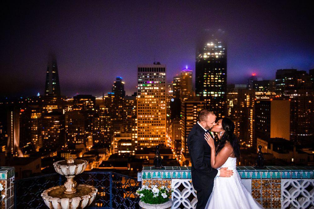 Wedding Kiss Against the Dark San Francisco Skyline, Twilight Hour