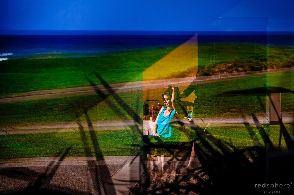 Window Reflection of Bride Preparing for Pebble Beach Wedding