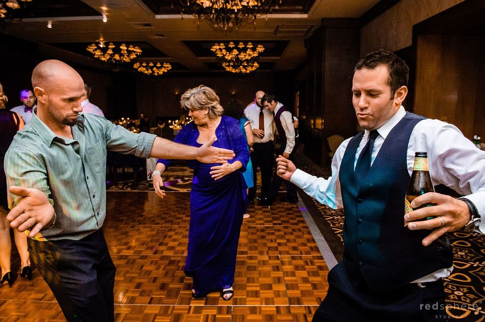 Friends and Family Dancing and Drinking at Pebble Beach Wedding After Party