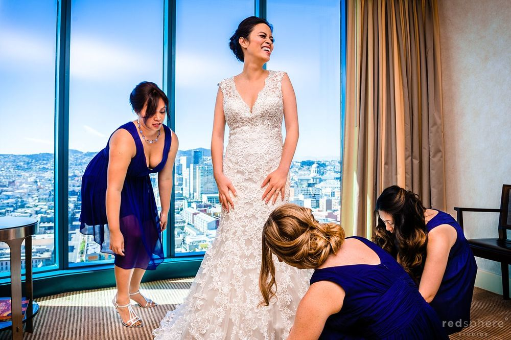 Bridesmaids' Help Bride Adjust her Wedding Gown at Intercontinental Hotel