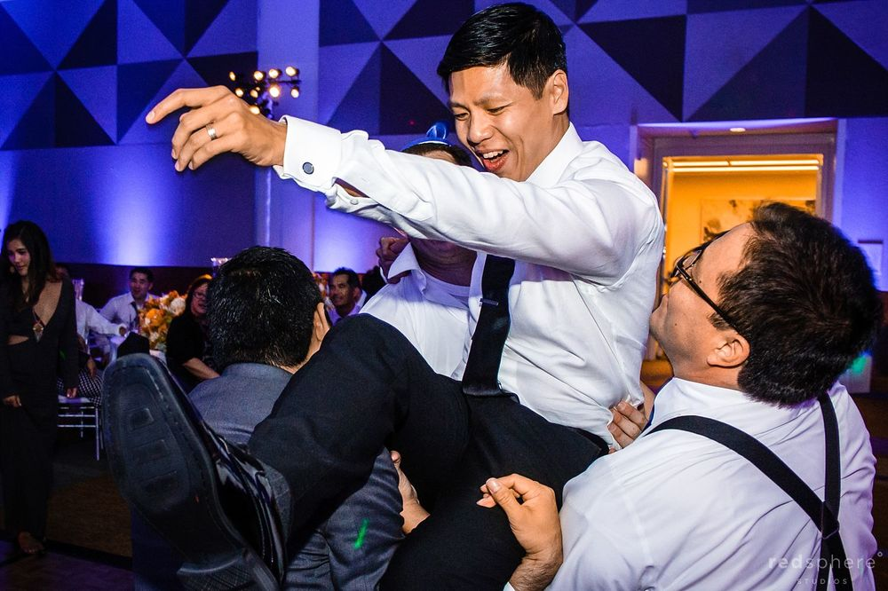 Groom Crowd Surfing at Wedding Reception, San Francisco