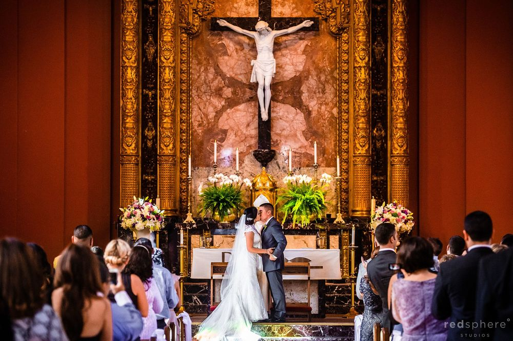 The Groom Kisses The Bride at St. Gregory Catholic Church