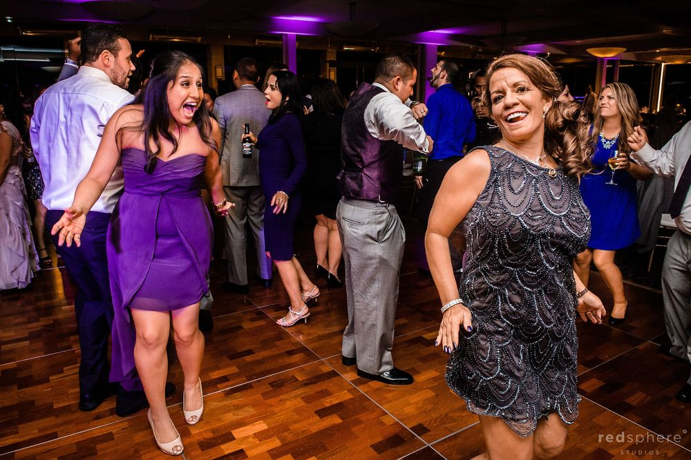Guests Having fun While They Celebrate Their Friends Wedding