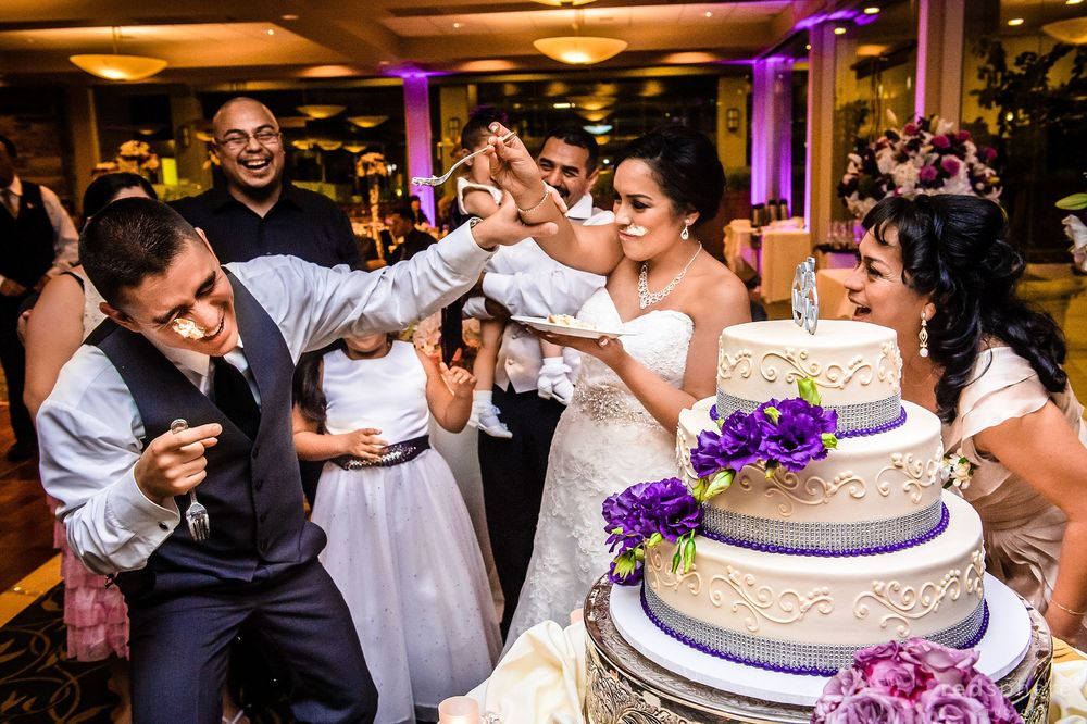 Bride Playfully Feeding Wedding Cake to the Groom