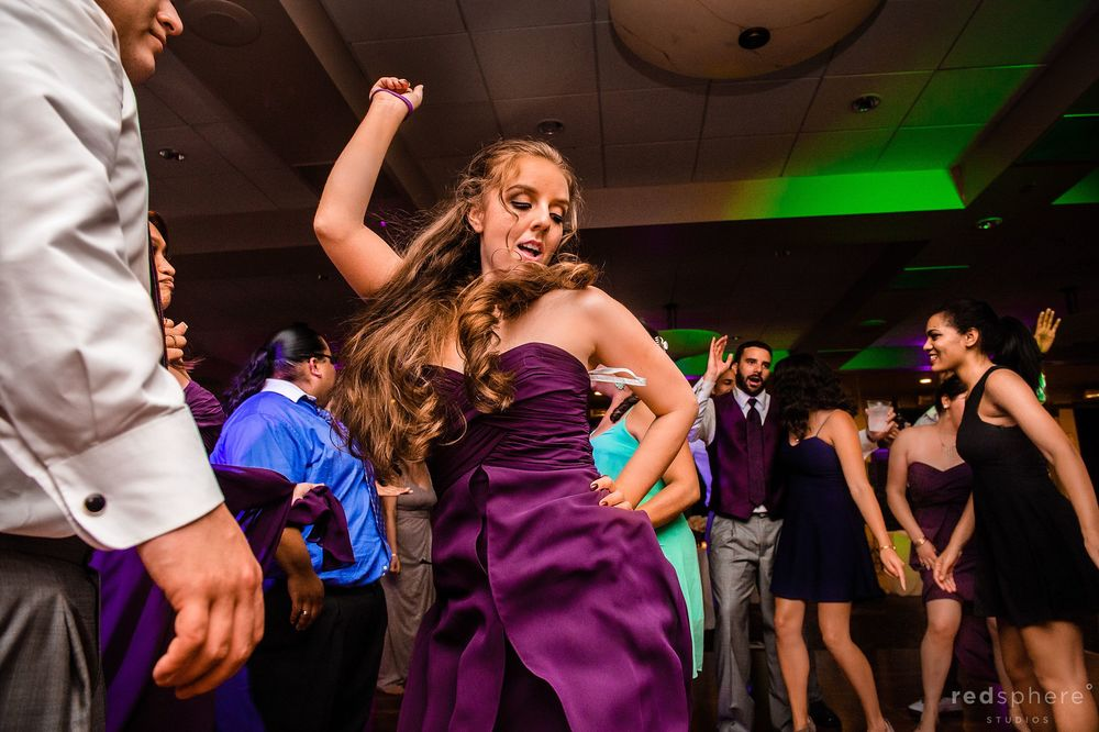 Bridesmaid Showing off her Moves at Wedding After Party