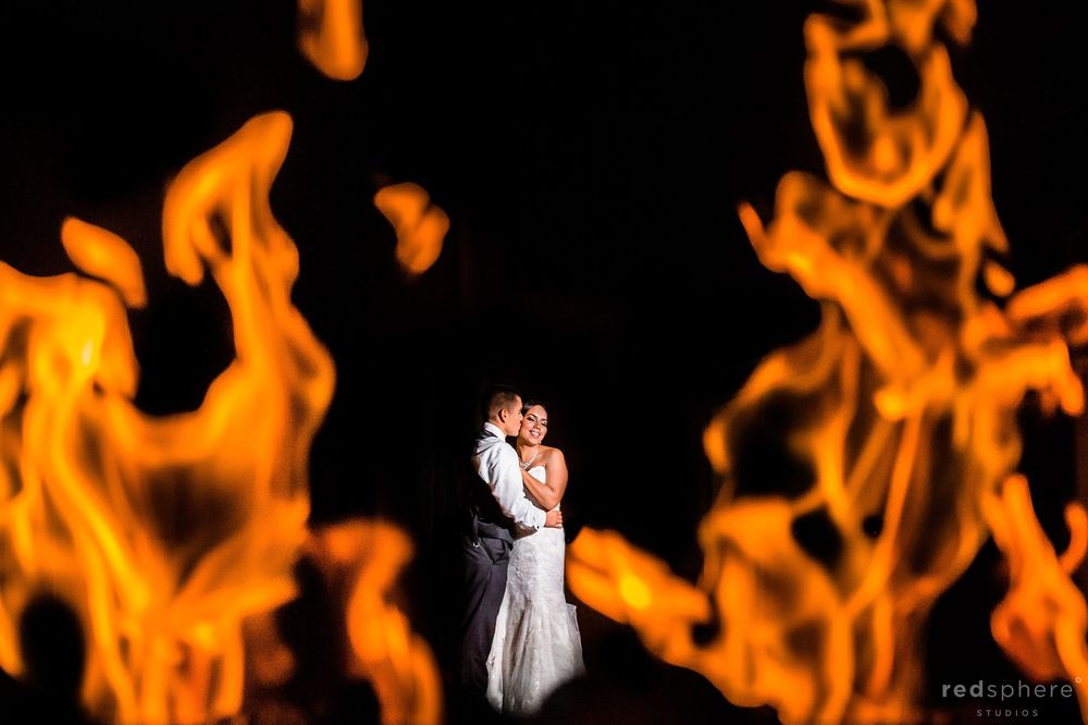 Groom Kisses Bride, Fireplace