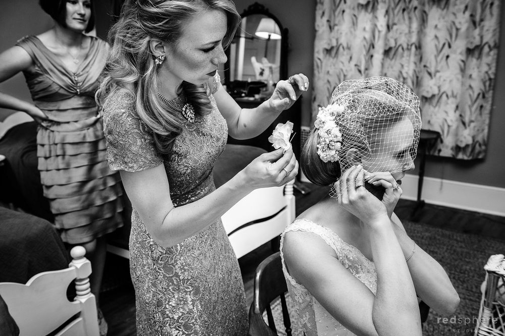 Bride in her Wedding Gown and Veil Putting on her Earring, Black and White Candid