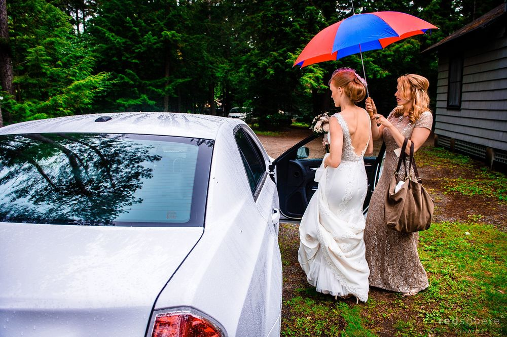 Bride Getting Into the Car Heading to Wedding on a Rainy Day