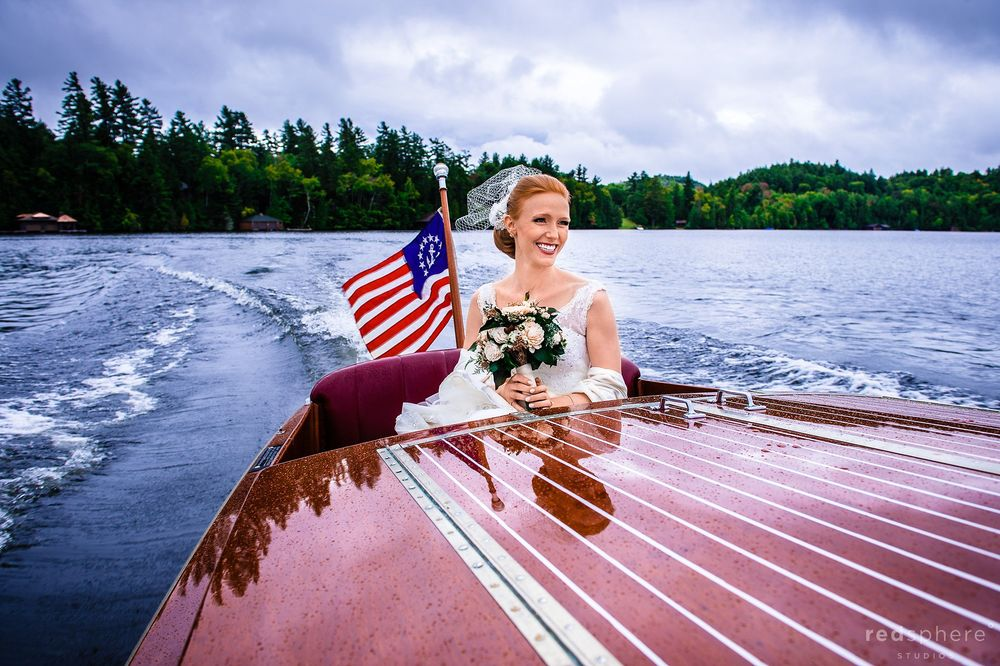Bride Sails With the Wind on Boat Ride at Saranac Lake, New York