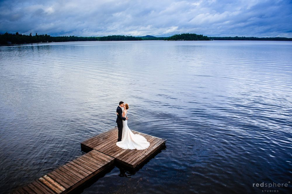 Bride and Groom on Saranac Lake Dock Aerial View