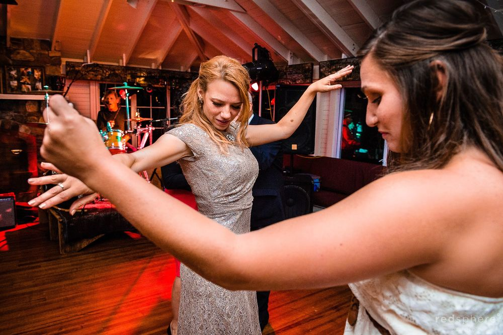 Maid of Honor Dancing With a Friend at Chapel Island Wedding Reception