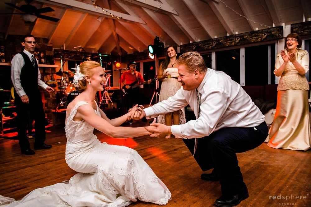 Bride Dancing Low With Family at Wedding Reception