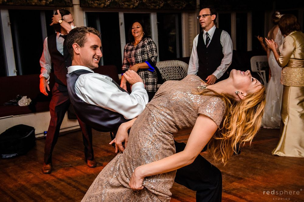 Maid of Honor and Groomsmen Getting Down While Dancing