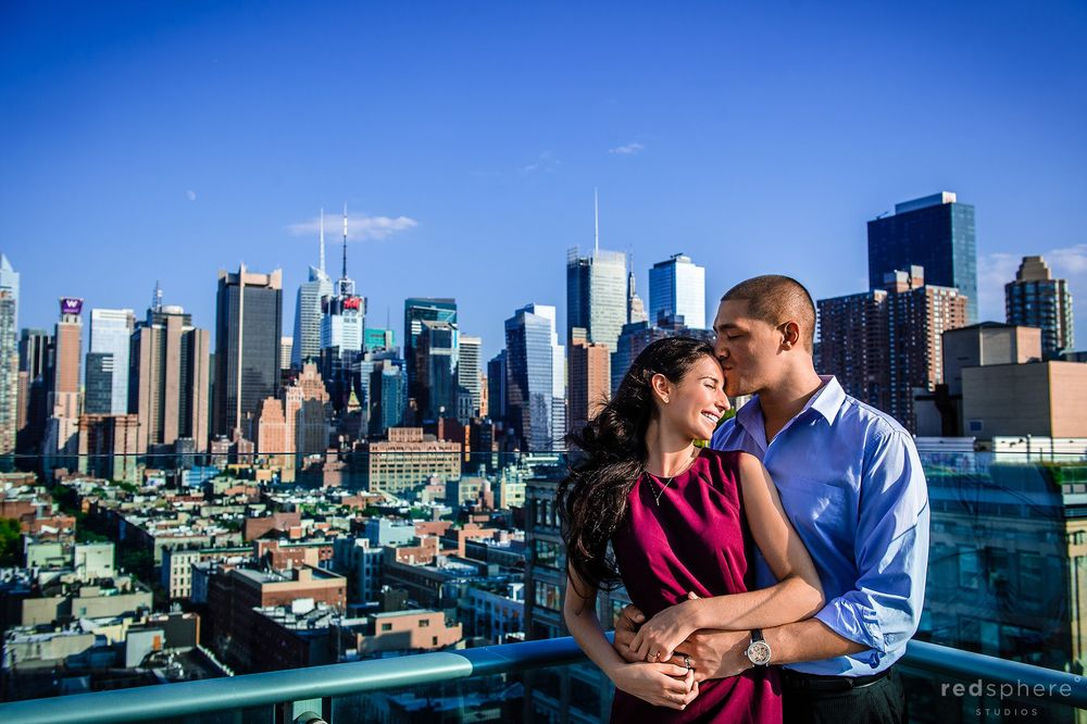 Couple Engagement on New York City Balcony With Skyline