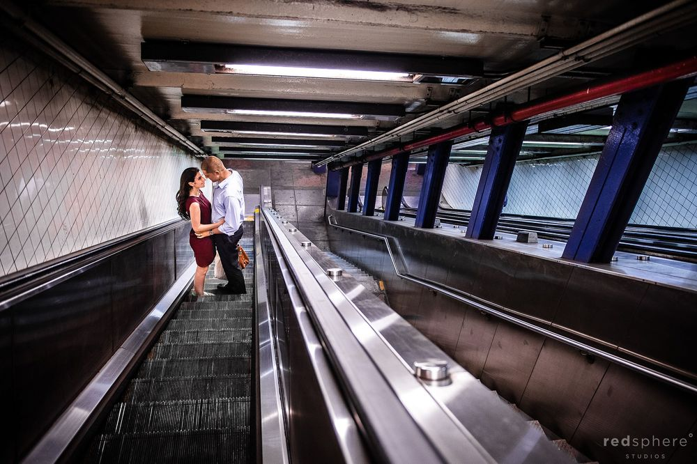 Couple Look Into Each Other on NYC Subway Escalator