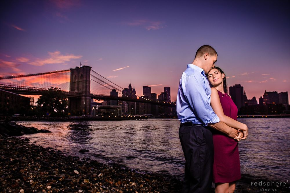 Engagement Session Along the Water of Brooklyn Bridge, NYC Sunset Dusk Hours