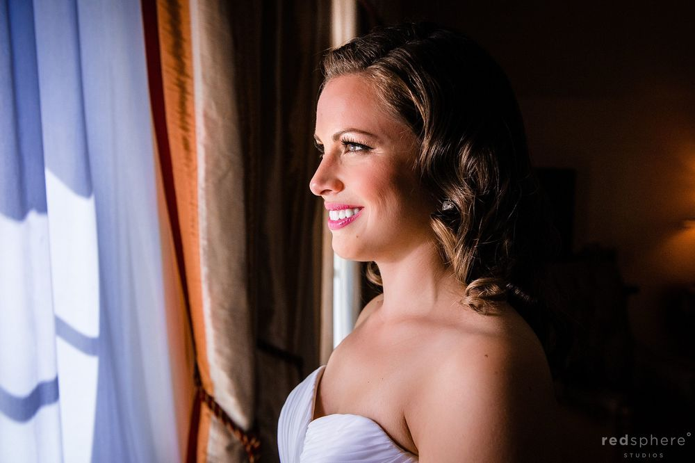 Bride Smiling and Looking Out the Window