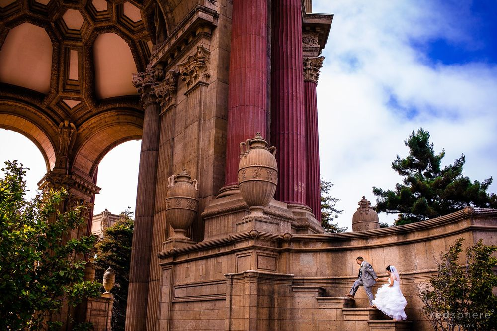 Married Couple Walking Up the Giants Steps at Palace of Fine Arts