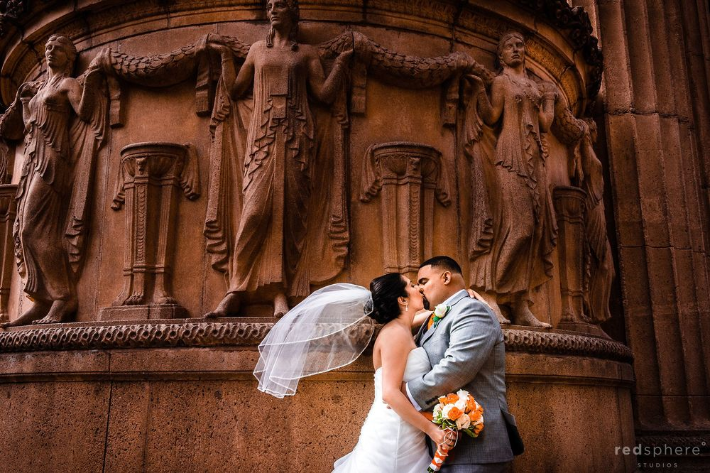 Bride and Groom Kiss as Wind Blows Veil at San Francisco's Palace of Fine Arts
