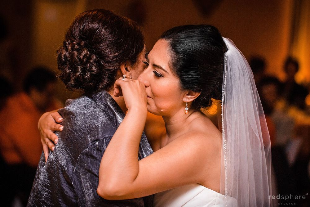 Bride Crying as she Hugs her Mother