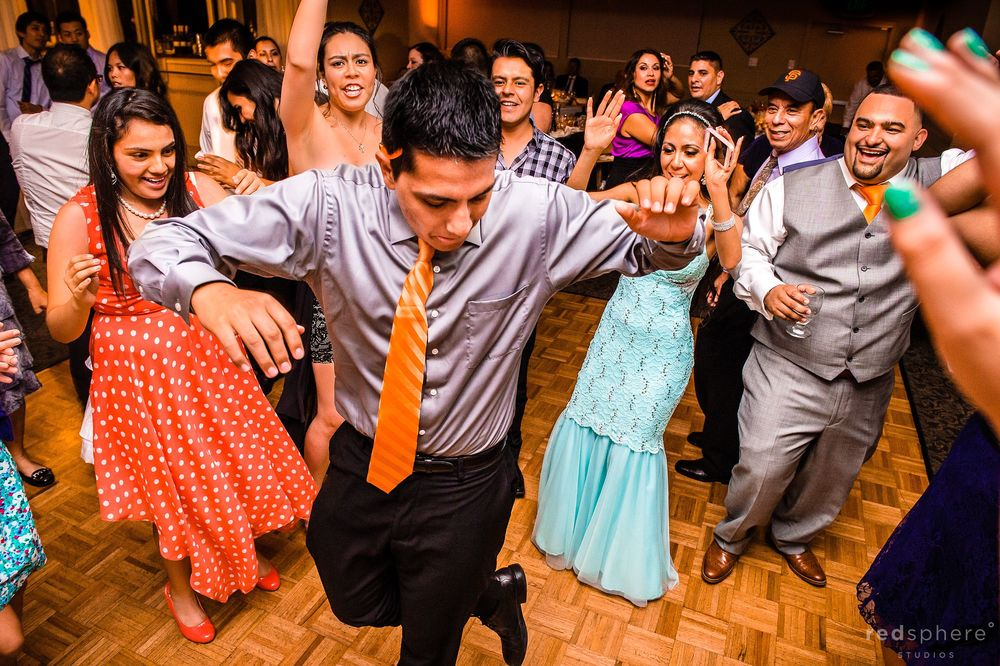 Groomsman Showing off his Dance Moves to a Guests