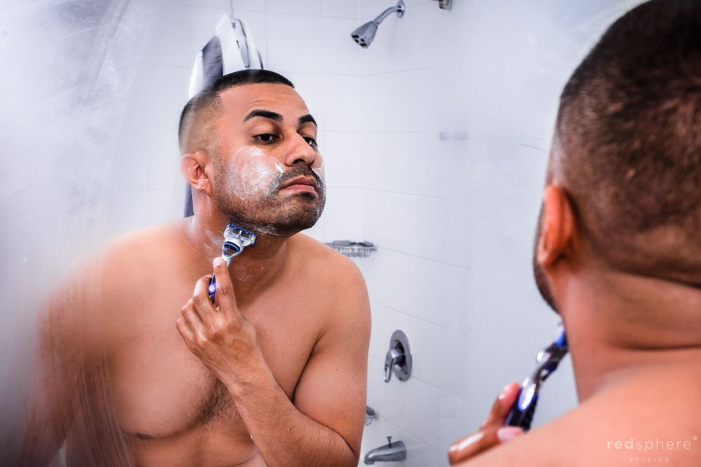 Groom Shaving Face as he Prepares for Wedding Day