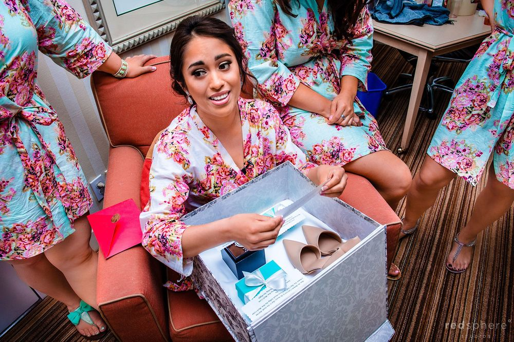 Bride Opens up Presents and Reads a Note in her Changing Room Before Wedding Ceremony