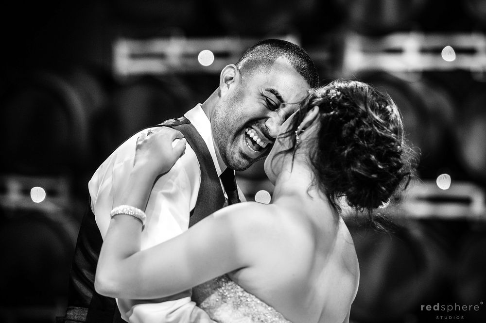 Bride and Groom Cheesing on Dance Floor