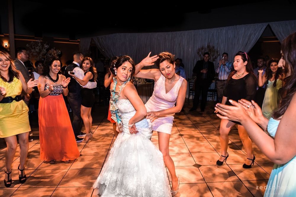 Bride and Friend Dance Together at Palm Event Center