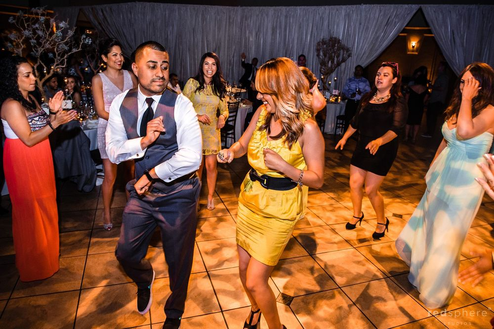 Groom and Friend Dancing Together While Guests Watch