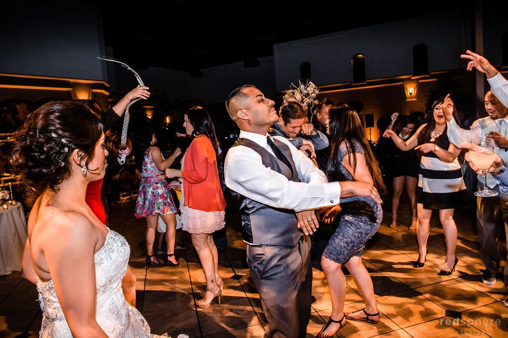 Bride Watches as Groom Parties at Palm Event Center, Pleasanton