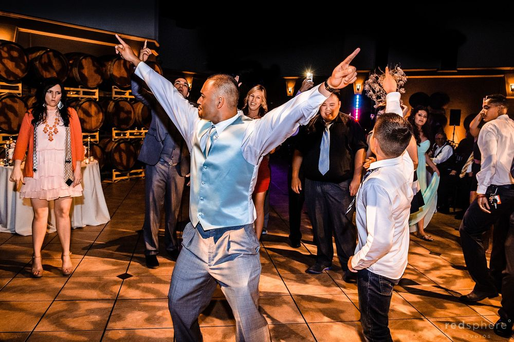 Guests Showing off Moves and Celebrate Newly Wed Couple at Palm Event Center Wedding Reception