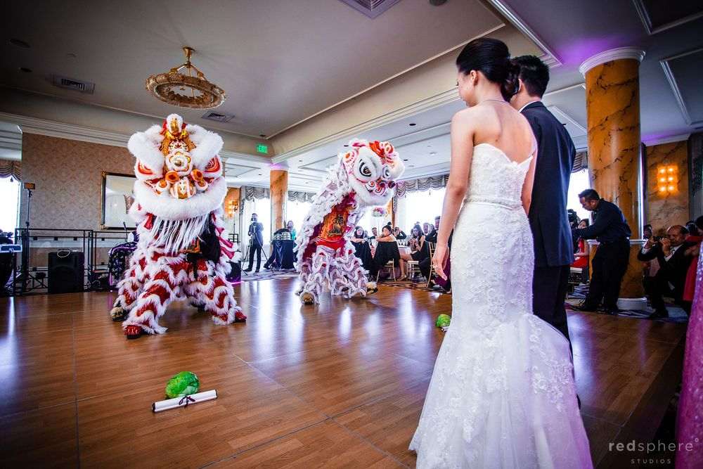 Bride and Groom Watch Traditional Chinese Lion Dance at Fairmont Wedding Reception