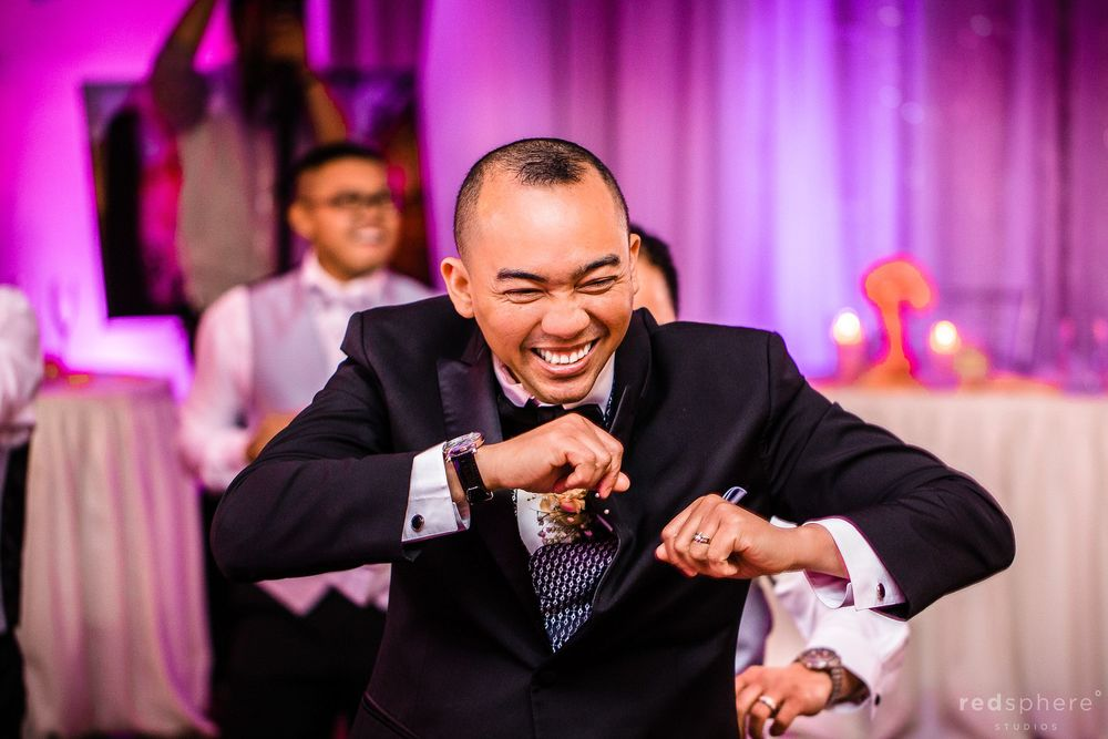 Groomsman Showing Dance Moves at Wedding Reception