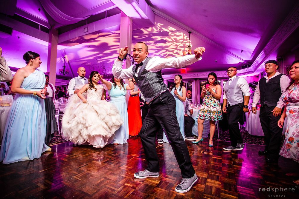 Groom Showing Off Dance Moves in the Middle of the Dance Floor
