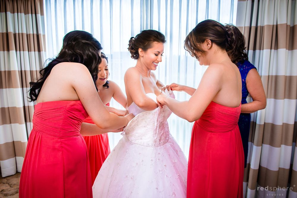 Bride Getting Fitted Into White Wedding Gown, Bridesmaids' Help Bride