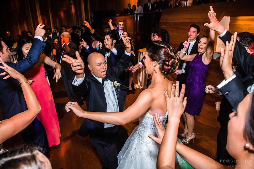 Bride Dancing With Good Friend as Guests Cheer Them On