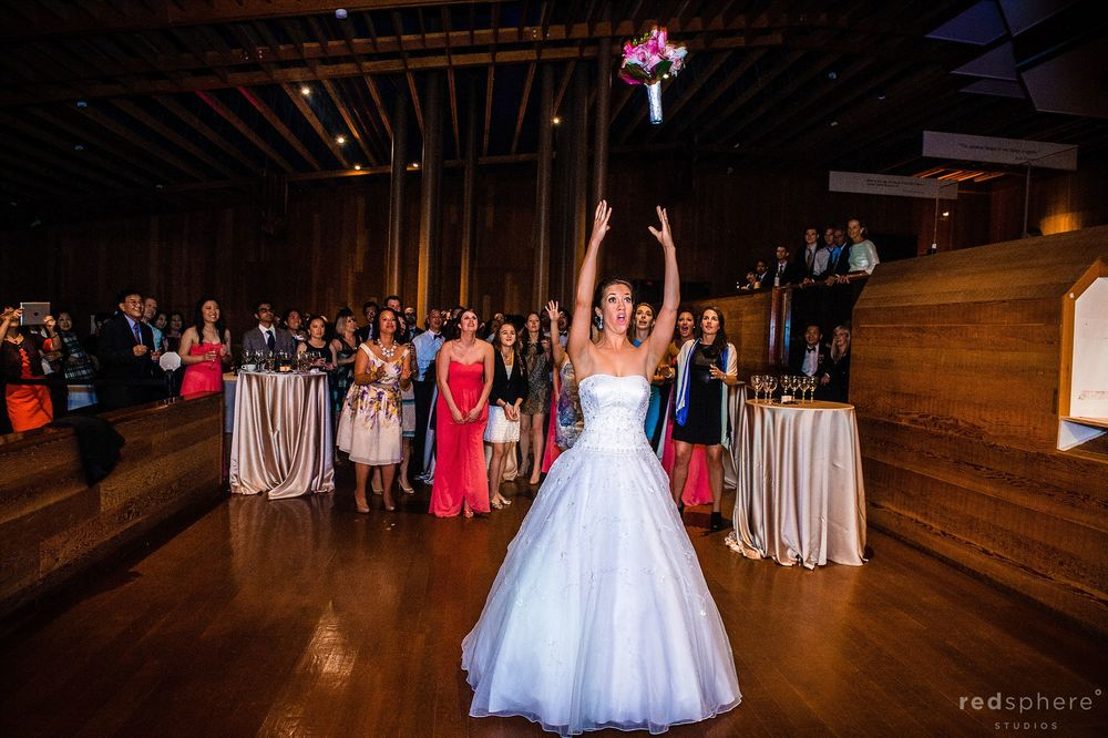 Bride Throws Her Bouquet Into the Air, Dance Floor Spotlight