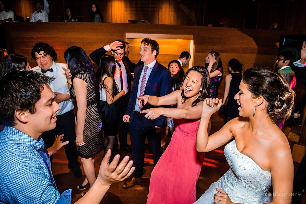Guests Pointing Fingers While Dancing With the Bride