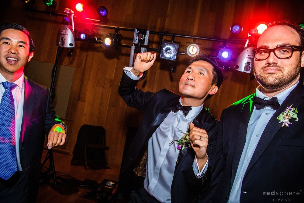 Groom Feeling The Music Alongside Close Friends