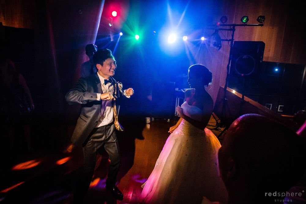 Bride and Groom Dancing Freely, DJ Light Flares