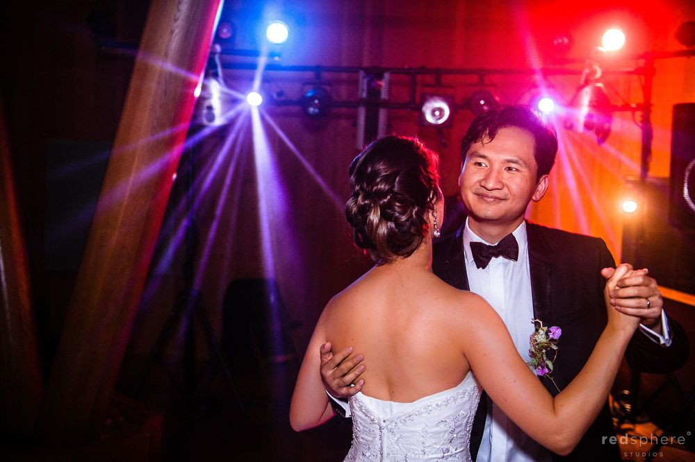Bride and Groom Share The Last Dance Together, Wedding Reception Party Lights