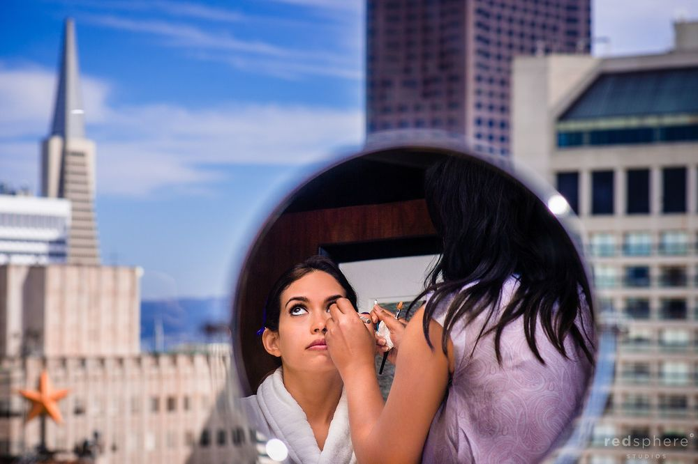 Bride Getting Eye Makeup Done With San Francisco City Skyline