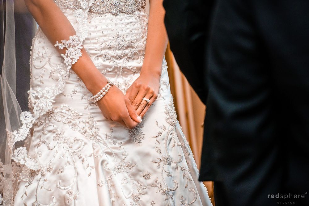 Bride's Nervous Hands Against White Elegant Wedding Dress