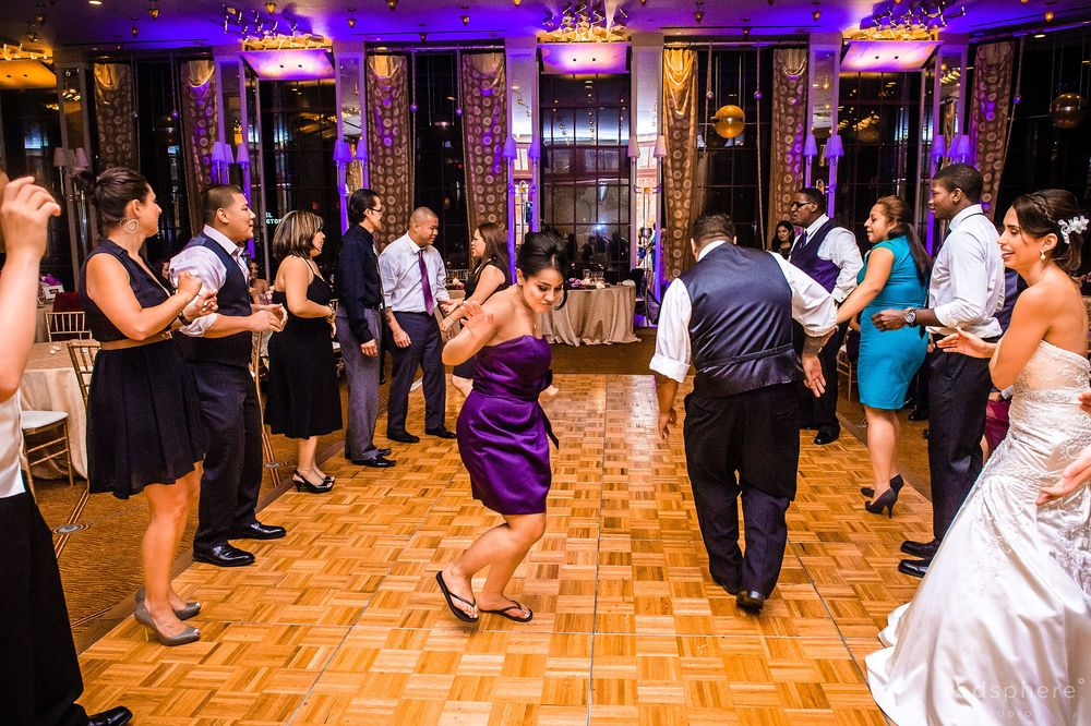 Bridesmaid Showing Off Dance Moves on the Dance Floor